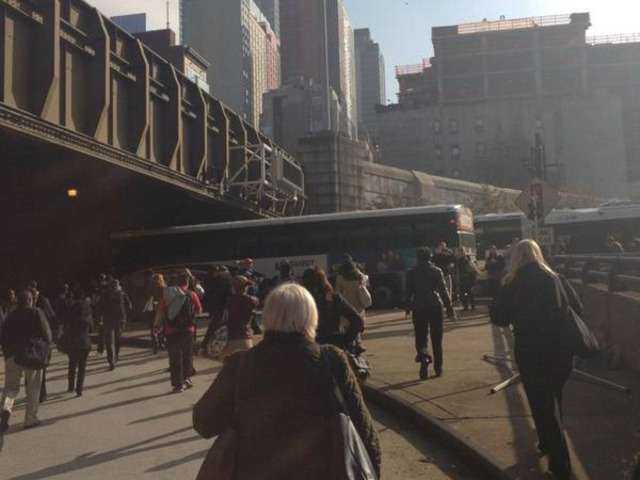<p>A bus crash injured roughly 20 and created hours-long traffic delays prompting some commuters to walk their way to work through the Lincoln Tunnel on Monday November 12, 2012.&nbsp;</p>