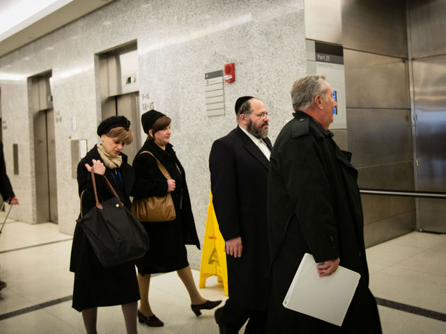 <p>Rabbi Nechemya Weberman arrives at Brooklyn Supreme Court for trial on Nov. 29, 2012. He was sentenced Tuesday to 103 years in prison for sexually assaulting a 12-year-old girl who went to him for counseling,</p>