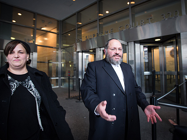 <p>Nechemya Weberman walks out of Brooklyn Supreme Court Nov. 30, 2012 with his two sisters.</p>