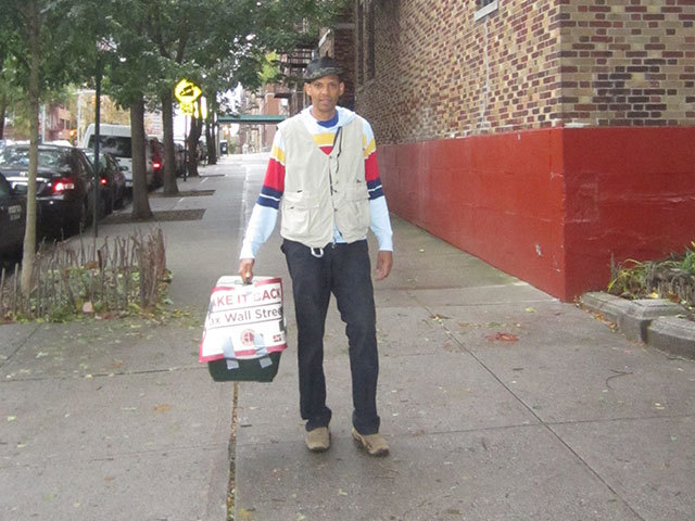 <p>Nelson Garo carries the guinea hen he caught the day after Hurricane Sandy in November 2012.</p>