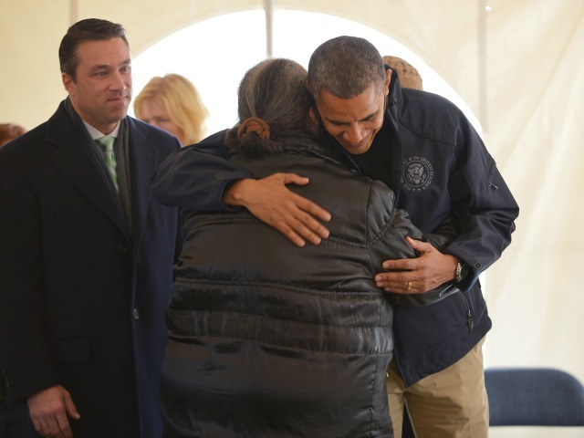 <p>President Barack Obama hugs a woman as he visits a Small Business Administration tent as he tours a FEMA Disaster Recovery Center (DRC) in the aftermath of Hurricane Sandy on Staten Island Nov. 15, 2012. FEMA has recently closed down this DRC, leaving only one open on Staten Island.</p>