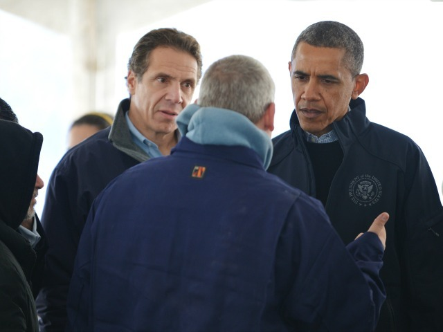 <p>President Barack Obama and Gov. Andrew Cuomo (L) chat with a man inside the distribution tent as he tours a FEMA Disaster Recovery Center (DRC) in the aftermath of Storm Sandy on Staten Island in New York on Nov. 15, 2012.</p>