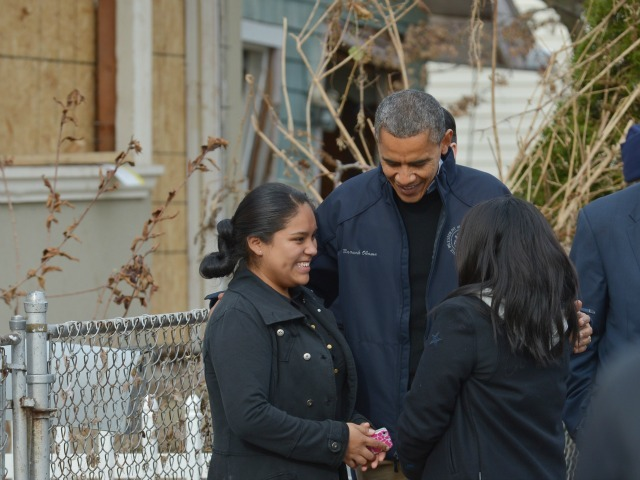 <p>President Barack Obama chats with residents as he visits Cedar Grove Avenue on Staten Island to visit areas stricken by Hurricane Sandy in New York City on Nov. 15, 2012.</p>