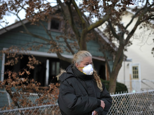<p>Local resident Debbie Ingenito waits for President Barack Obama as he visits Cedar Grove Avenue on Staten Island to visit areas stricken by Hurricane Sandy in New York City on Nov. 15, 2012.</p>