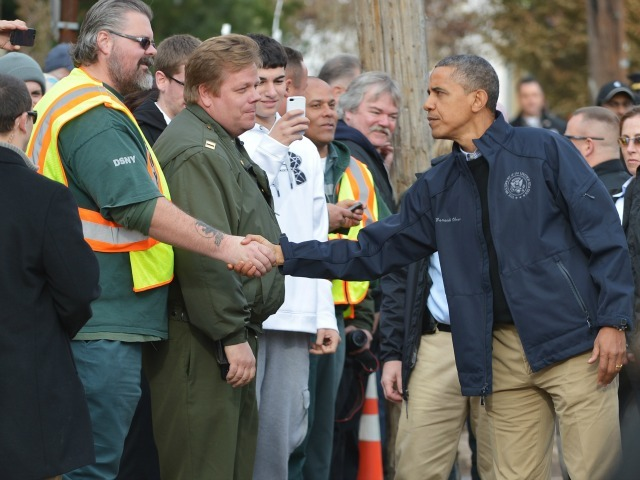 <p>President Barack Obama greets workers as he visits Cedar Grove Avenue on Staten Island to visit areas stricken by Hurricane Sandy in New York City on Nov. 15, 2012.</p>