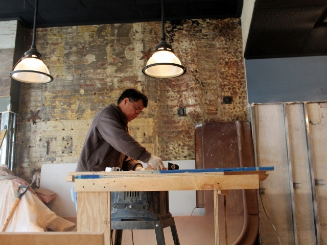 <p>A worker makes repairs at&nbsp; Fresh Salt, a bar and restaurant in the South Street Seaport that was devastated during Hurricane Sandy.</p>