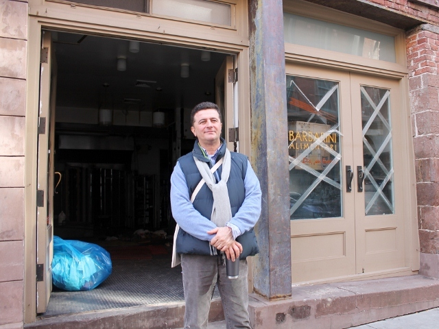 <p>Claudio Marini, owner of Barbarini Meracto on Fulton Street in the South Street Seaport, outside his shop, which flooded during Hurricane Sandy.</p>