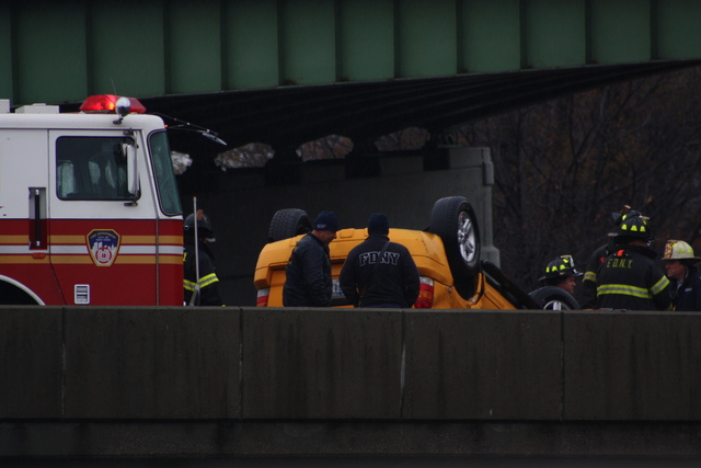 <p>A taxi overturned on a ramp leading from the Van Wyck Expressway to the Long Island Expressway Nov. 27, 2012.</p>