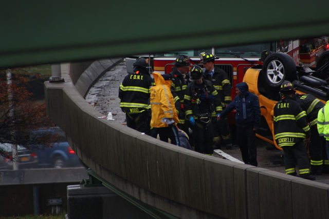 <p>Two people were hurt when a taxi overturned on a ramp leading to the Long Island Expressway Nov. 27, 2012.</p>