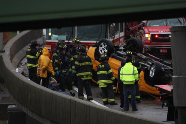 <p>A taxi flipped over in a single-car crash on a ramp leading to the Long Island Expressway in Queens Nov. 27, 2012.</p>