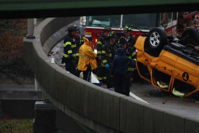 <p>A taxi flipped over on a ramp leading to the Long Island Expressway, injuring two people, Nov. 27, 2012.</p>