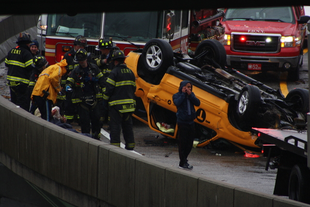 <p>A taxi flipped over on a ramp leading to the Long Island Expressway Nov. 27, 2012.</p>