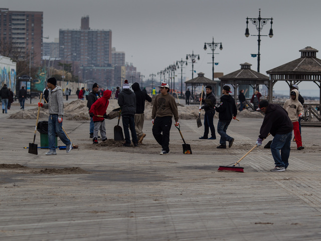 <p>Parks Dept. volunteers help with the Coney Island Beach cleanup on Nov. 10, 2012.</p>