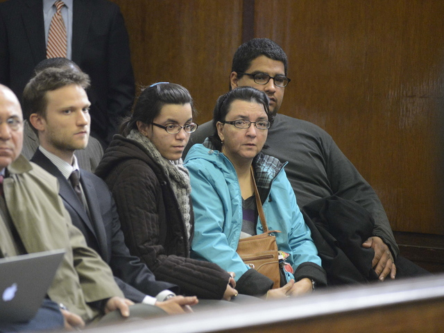 <p>Rosemary Hernandez and her daughter appear in Manhattan Criminal Court on November 15, 2012</p>