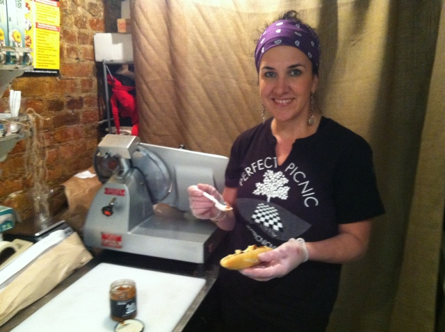 <p>Wendy Weston prepares sandwiches at the Perfect Picnic&#39;s new store at 123 Ludlow St.</p>