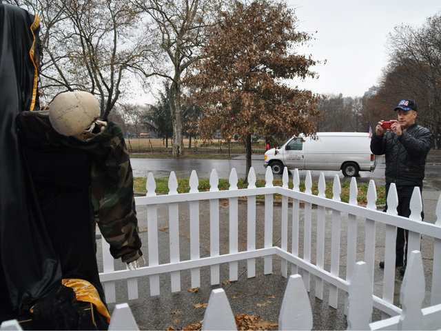 <p>Army veteran Eddie Algarin&nbsp;stopped to take pictures of the sculpture when he noticed it on Tuesday, Nov. 27, 2012.</p>