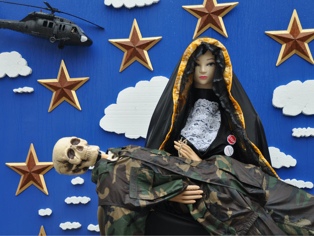 <p>A skeleton in Army uniform stood in for Jesus in the modified &quot;Pieta&quot; sculpture on McCarren Park&#39;s edge.&nbsp;</p>