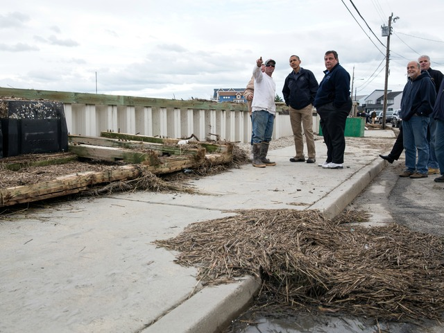 <p>President Barack Obama and New Jersey Gov. Chris Christie talk with citizens who are recovering from Hurricane Sandy, while surveying storm damage in Brigantine, N.J., Oct. 31, 2012.</p>