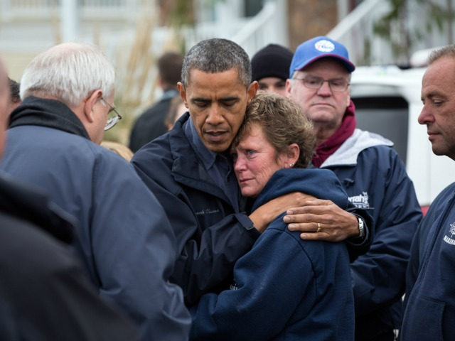 <p>President Barack Obama hugs Donna Vanzant, the owner of North Point Marina, as he tours damage from Hurricane Sandy in Brigantine, N.J., Oct. 31, 2012.</p>