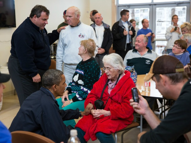 <p>President Barack Obama and New Jersey Gov. Chris Christie talk with local residents at the Brigantine Beach Community Center, which is serving as a shelter for those displaced by Hurricane Sandy, in Brigantine, N.J., Oct. 31, 2012.</p>