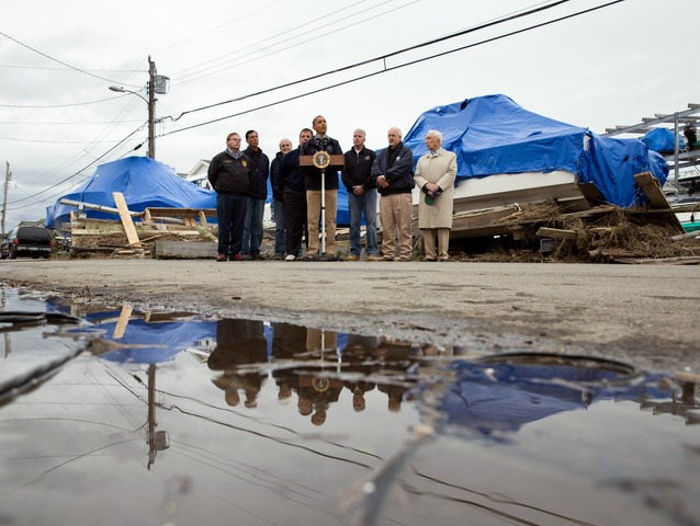 <p>President Barack Obama, center, along with New Jersey Gov. Chris Christie, FEMA Administrator Craig Fugate, and other officials, makes a statement after touring Hurricane Sandy storm damage in Brigantine, N.J., Oct. 31, 2012.</p>