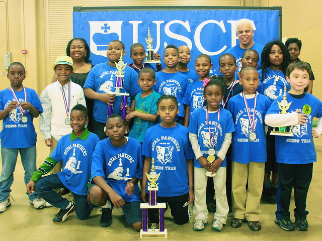 <p>Members of the P.S. 282 chess team pose with trophies and medals at a national chess tournament in Nashville, Tenn., in 2012.</p>