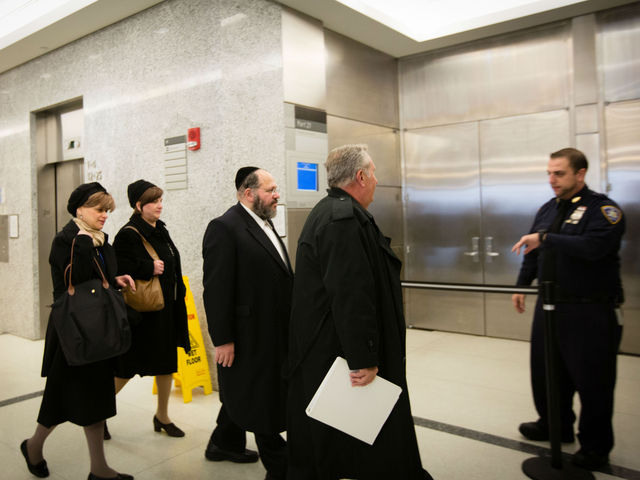 <p>Rabbi Nechemya Weberman arrives at Brooklyn Supreme Court for his sexual assault trial, Nov. 29, 2012.</p>