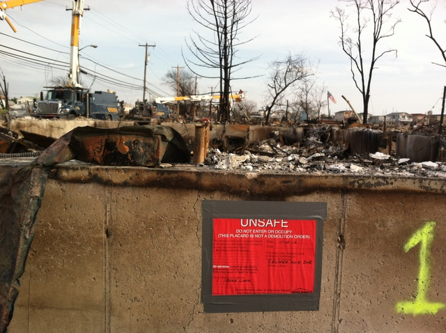 <p>A red placard issued by the Department of Buildings, noting a structure that is too unsound to enter, in Breezy Point on Nov. 18, 2012.</p>