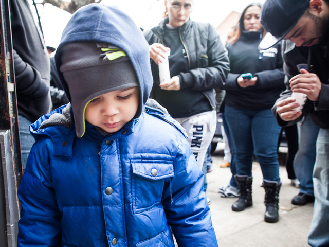 <p>A little boy joins relatives who gathered to mourn Destiny Sanchez on Nov. 24, 2012.</p>