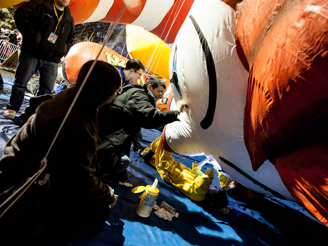 <p>The giant Ronald McDonald inflatible balloon gets a clean-up before the annual Thanksgiving Day Parade on Nov. 21st, 2012.</p>