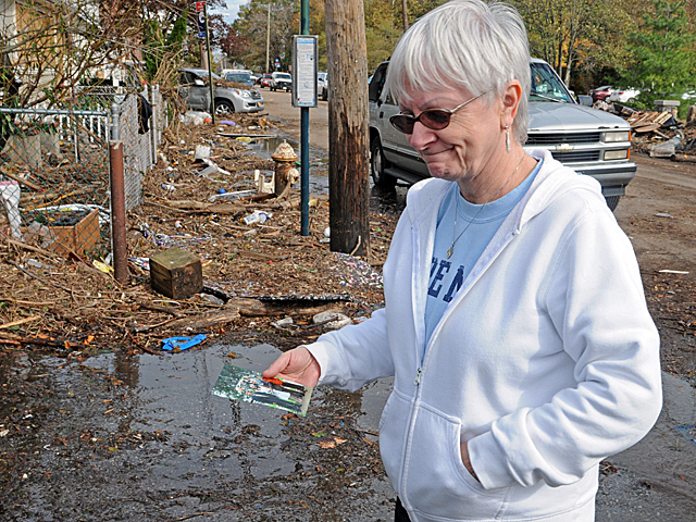 <p>Sheila Traina, whose New Dorp home was destroyed during Hurricane Sandy, inspects the damage after the storm, Nov. 1, 2012.</p>