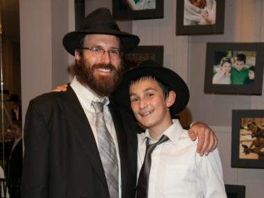 Simcha Levenberg and his son, Ephraim.