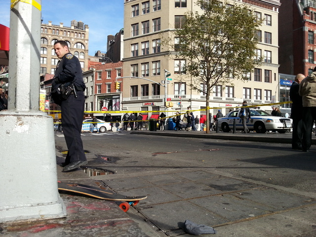 <p>A man riding a skateboard was struck by a truck and critically injured on Broadway near Union Square Tuesday afternoon, Nov. 20, 2012. The man&#39;s skateboard is visible at left, near the base of the light post.</p>