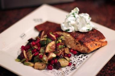 A cool, cucumber relish and smoky, sweet Brussels sprouts balance this spicy fish dish.