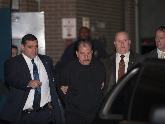 <p>Triple murder suspect, 63-year-old Salvatore Perrone, walks out of the 67th Precinct in Brooklyn on Wednesday Nov. 21, 2012.</p>