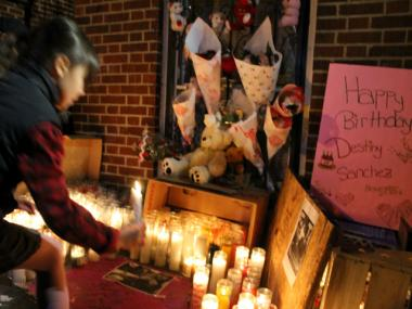A large crowd held a candlelight vigil and march through Hunts Point on Nov. 26, 2012 in honor of 15-year-old Destiny Sanchez, who was found strangled and smothered at 640 Barretto St. on Nov. 23, 2012.