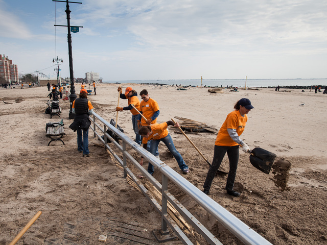 <p>Volunteers helps with the Coney Island Beach cleanup on Nov. 10, 2012.</p>
