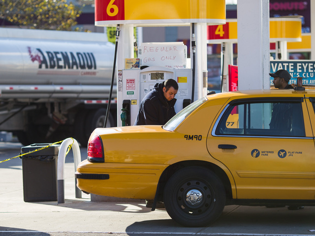 <p>A yellow cab driver re-fuels at the Shell gas station on Northern Blvd., in Queens on Nov. 9, 2012.</p>