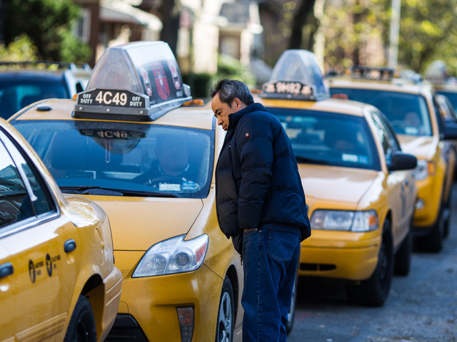 <p>A yellow cab driver waits in line for fuel outside the Shell gas station in Queens on Nov. 9, 2012.</p>