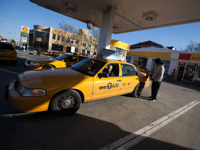 <p>A yellow cab gets re-fueled at the Shell gas station in Jackson Heights, Queens on Nov. 9, 2012.</p>
