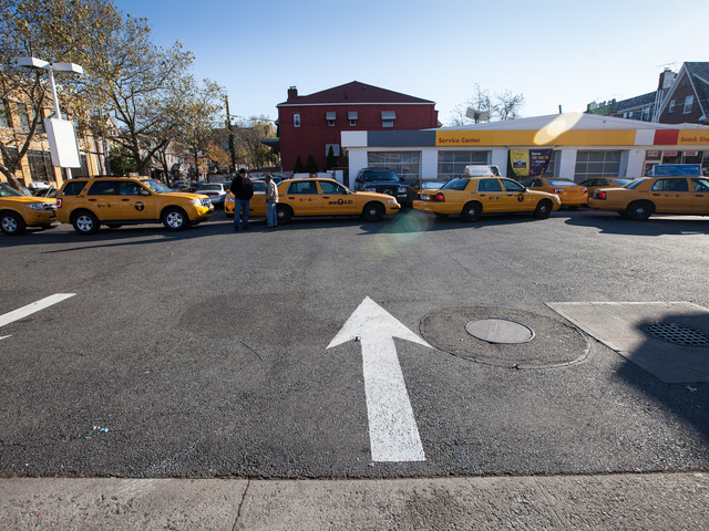 <p>Yellow cabs line up for fuel at the Shell gas station in Queens on Nov. 9, 2012.</p>