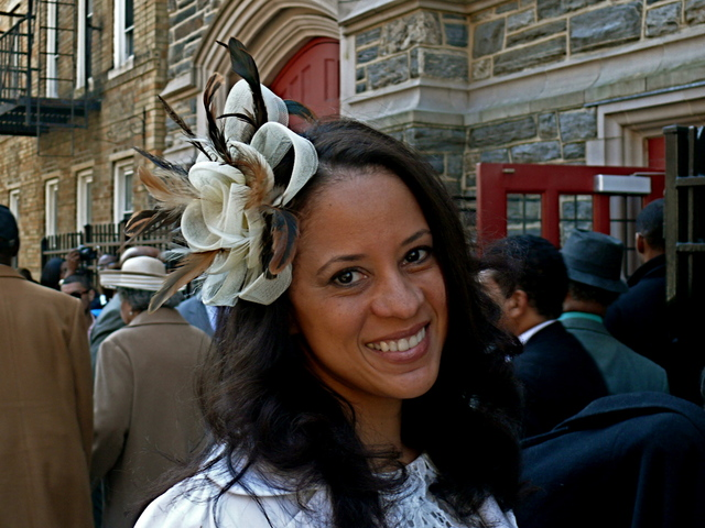 <p>Michelle R. in a rich trimmed fascinator with plumesAbyssinian Baptist Church in Harlem.</p>