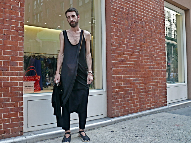 <p>Spanish fashion designer Joseba wore inky black and indigo draped knit ensemble by Comme des Gar&ccedil;ons in SoHo.<br /> 	&nbsp;</p>
