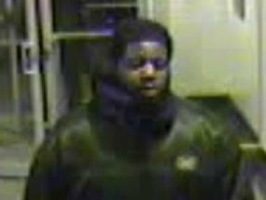 Cops are looking for a man they believe shoved a woman to the ground and stole her purse on November 25, 2012.