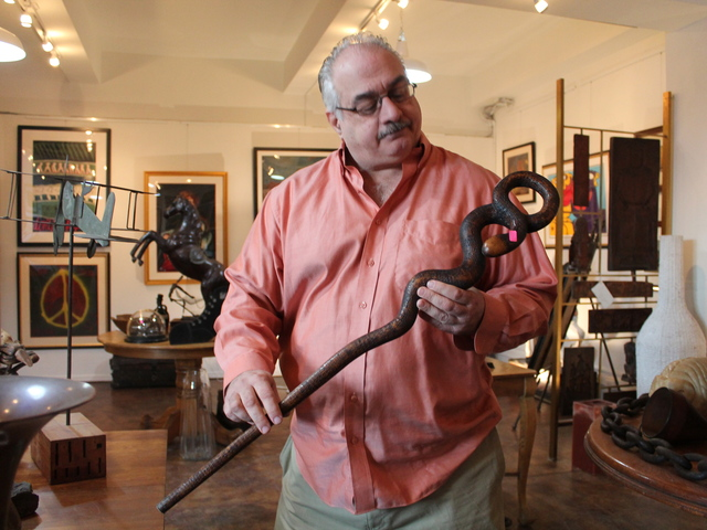 <p>A financial advisor by day, Bart Tarulli, 61, opened 7 Continents Art on Broadway in Astoria on Dec. 1, 2012, selling arts and antiques he&#39;s collected from around the globe.</p>