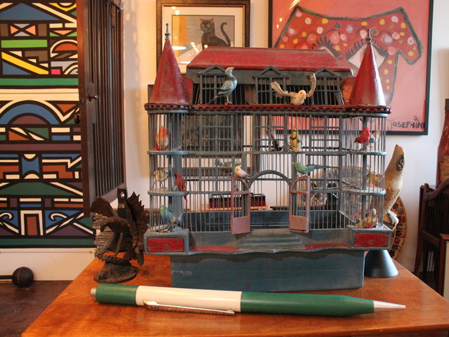 <p>A bird cage from the 1930s modeled to look like a French chateau which is part of the collection at 7 Continents Art in Astoria.</p>