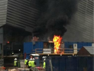 A fire in storage containers sent smoke billowing over the World Trade Center site Wednesday.