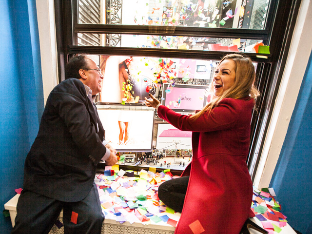 <p>This year&#39;s Times Square New Year&#39;s Eve host Allison Hagendorf and Alliance President Tim Tompkins throw confetti from eight stories above Times Square during the annual Airworthiness Test on Dec. 29th, 2012.</p>