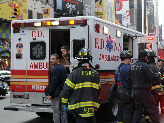 <p>An ambulance at the scene where a man was struck and killed by a Q train at 49th Street and Seventh Avenue.</p>