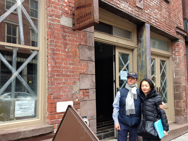 <p>Claudio and Linda Marini, owners of shuttered Front Street restaurant Barbarini, stand outside of their flood-wrecked eatery. With repairs likely to take more than six months, the Marinis are looking to open a new restaurant in the Financial District, with help from a newly launched funding site.</p>